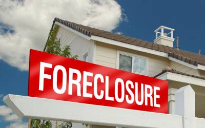 Foreclosure sign outside house