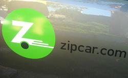 Zipcar logo on side of car