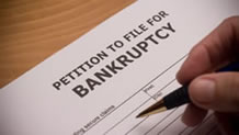 Hand filling out bankruptcy petition