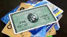 American Express card on top of pile of credit cards