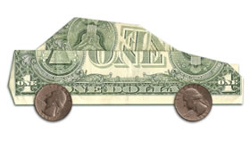 Dollar bill shaped like a car with quarters for wheels