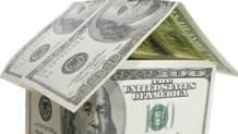Hundred dollar bills in shape of house