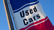 Red, white and blue Used Cars banner