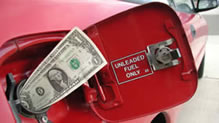 Dollar bill sticking out of gas tank