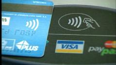 Credit card with wave-and-pay device