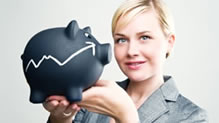 Woman holding black piggy bank with arrow