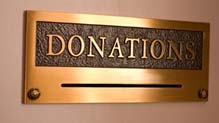 Donations sign on building