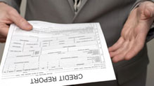 Man holding credit report