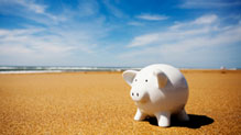 White piggy bank on beach