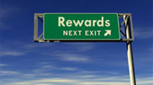 Highway sign with the words Rewards-Next Exit