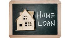 Home loan written on blackboard