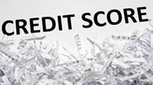 Word credit score over shredded paper