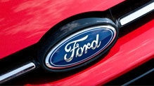 Ford oval badge on red car hood