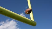 Football sailing over goalpost
