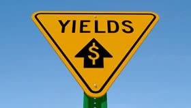 Yields sign with arrow pointing up and dollar sign