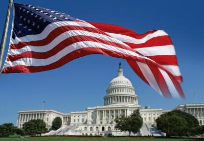 U.S. flag flying over Capitol