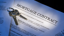 House keys on top of mortgage contract