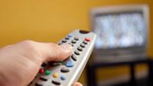 Hand aiming remote at TV