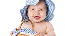 Smiling baby in blue hat