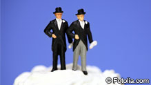 wedding cake with two men  in the cake topper.
