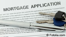 Keys on top of mortgage contract