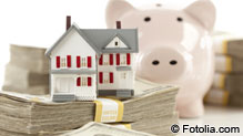 Piggy bank with house and money