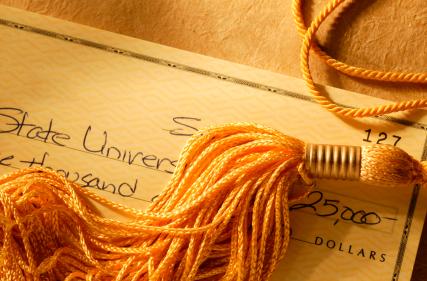 Graduation tassel on top of checkbook
