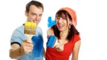 Couple holding paintbrushes