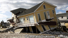 Yellow oceanfront home damaged by hurricane sandy