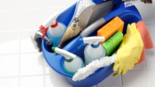 blue bucket filled with cleaning products