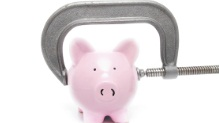 Piggy bank in a vise clamp