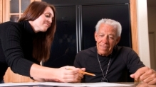 woman going over a budget with an older man