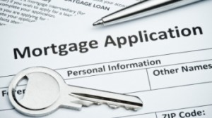 image of a mortgage application with a key and a pen on top
