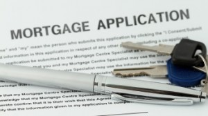 Pen and keys on mortgage application