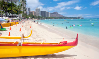 waikiki beach with outrigger canoes and diamond head crater in background. Waikiki, Honolulu, Oahu, Hawaii, USA