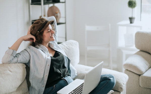 Young women using laptop on sofa