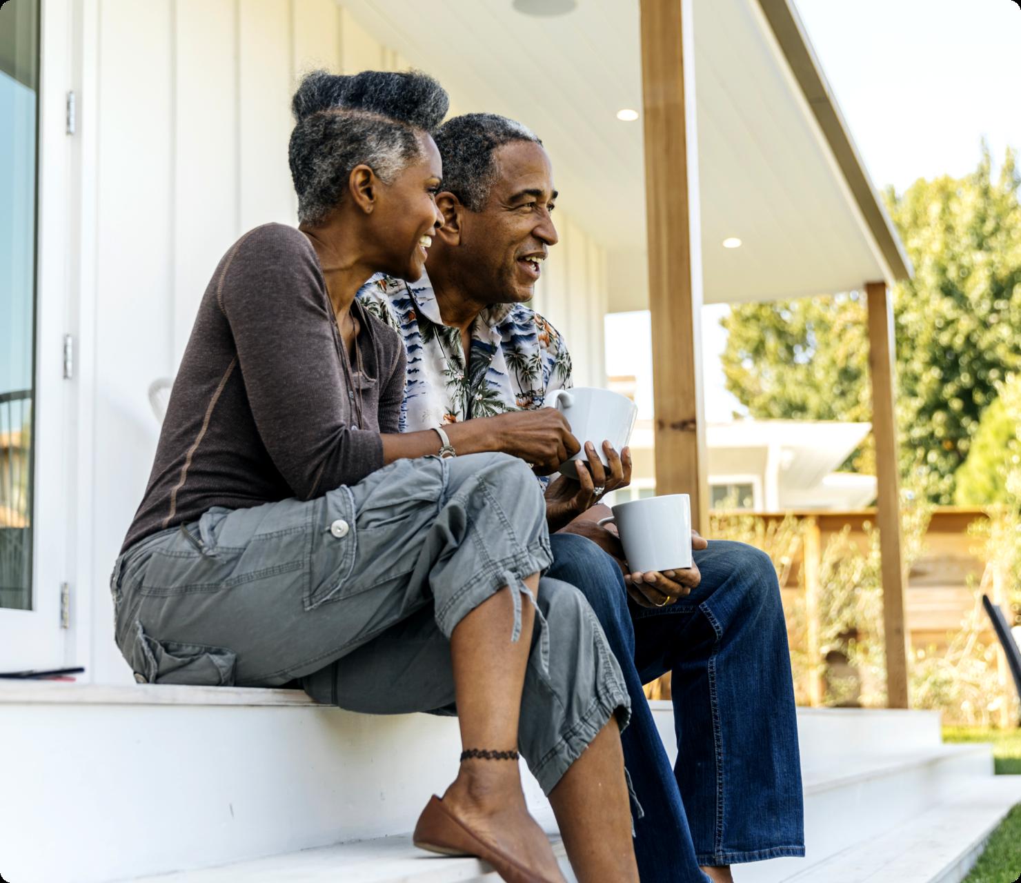 Elder couple drinking coffee on their porch